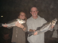 john-and-nina-consulting-a-pair-of-bass-caught-on-live-sandeel-at-courtmacsherry-on-the-1st-october